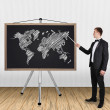 Businessman pointing at world map — Stock Photo