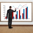 Businessman drawing graph — Stock Photo