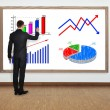 Stock Photo: Businessmdrawing graph