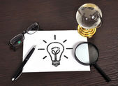Lamp on paper — Stock Photo