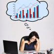 Sad woman and chart — Stock Photo