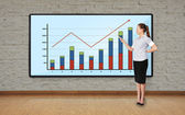 Woman pointing at chart — Stock Photo