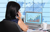 Woman and chart on screen — Stock Photo