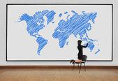 Woman drawing world map — Stock Photo