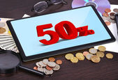 Tablet with discount — Stock Photo