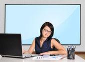 Woman and plasma panel — Stock fotografie