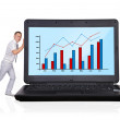 Laptop with business chart — Stock Photo