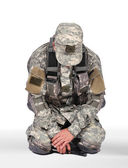 Soldier kneeling — Stock Photo