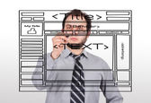 Businessman drawing website — Stock Photo