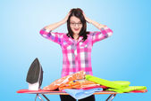 Young girl ironing clothes — Stock Photo