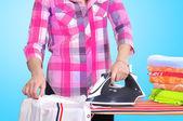Girl ironing clothes — Stock Photo