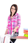Woman ironing clothes — Stockfoto