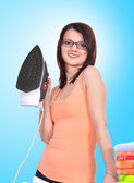 Woman holding steam iron — Stock Photo