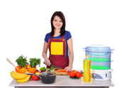 Woman cooking food — Stock Photo