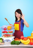 Housewife with spoon — Stock Photo