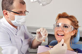 Dentist cleans teeth — Stock Photo