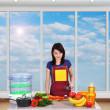 Girl chef in kitchen — Stock Photo