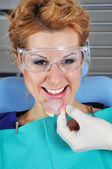 Dentist puts denture — Stock Photo