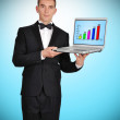 Laptop with chart on screen — Stock Photo