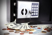 Dollars and safe — Stock Photo