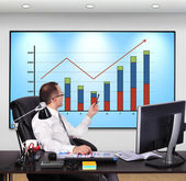 Businessman pointing to chart — Stock Photo