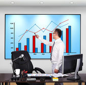 Man pointing to chart — Stock Photo