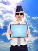 Flight attendant holding touch pad — Stock Photo