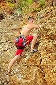 Climber climbing a rock — Stock Photo