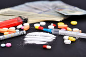 Lines of cocaine and narcotic — Stock Photo