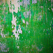 Old board with peeling paint of green and gray — Stock Photo