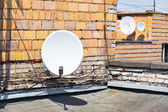 Satellite dish on the roof of the building — Stock Photo