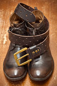 Leather shoes and leather belt brown with gold buckle — Stock Photo