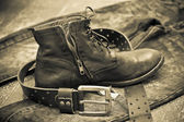 Fashionable leather shoes, leather belt and jeans. cowboy style — Stock Photo
