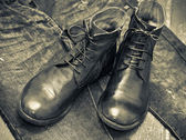 Leather shoes brown and blue jeans.leather high boots. — Stock Photo