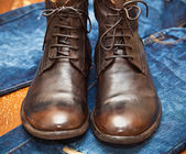 Leather shoes brown and blue jeans. luxury handmade shoes. — Stock Photo
