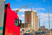 Truck cab red color on a background of construction — Stockfoto