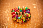 Multi colored bracelet in the Latin American style, Vintage background — Stock Photo