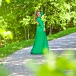 Beautiful girl in a long dress in the park. fashion Photography — Stock Photo #46968223