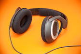 Headphones on an orange background — Stock Photo