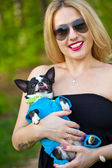 Beautiful woman with chihuahua dog sticks out his tongue and smiling — Stok fotoğraf