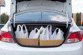 Shopping bags are in the car trunk — Stock Photo