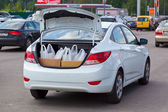 Shopping bags into the car trunk — Stock Photo