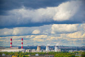 Industrial district, fuming industrial chimney. Blue sky with cumulus clouds — Stock Photo