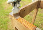 Painting wood furniture — Stock Photo