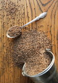 Cumin seeds on wooden background — Stock Photo
