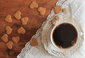 Coffee cup and cookies on a wooden table — Stock Photo