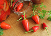 Red chili peppers on wooden table — Stock Photo
