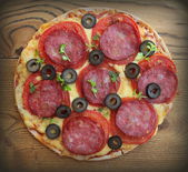 Pizza with tomato, sausage, cheese, olives — Stock Photo