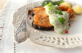 Roasted salmon with sauce — Stock Photo