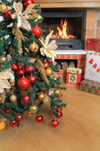 Christmas Tree and Christmas gift boxes in the interior with a fireplace — Stock Photo
